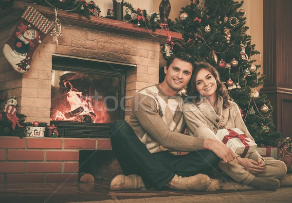 Couple near fireplace in Christmas decorated house interior  Stock photo © Nejron