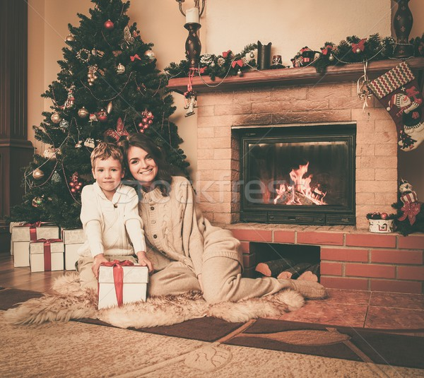 Stock photo: Happy mother with her son in Christmas decorated house interior
