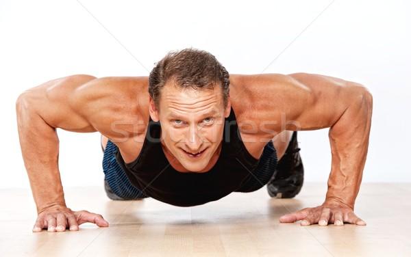 Jóképű izmos férfi fitnessz dolgozik izom Stock fotó © Nejron
