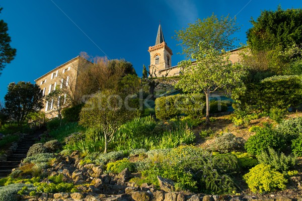 Bell tower and house on a garden hill Stock photo © Nejron