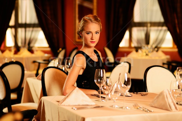 Young beautiful girl alone in a luxury restaurant  Stock photo © Nejron