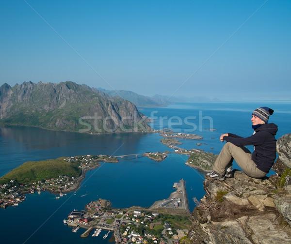 Woman hiker looking at Reine village panorama, Norway Stock photo © Nejron
