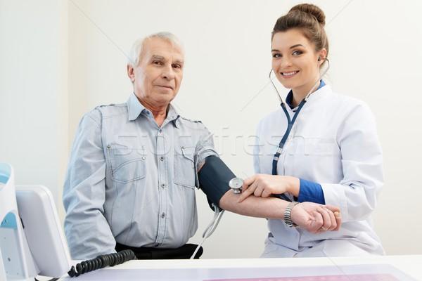 Idős férfi iroda találkozó papír orvos Stock fotó © Nejron