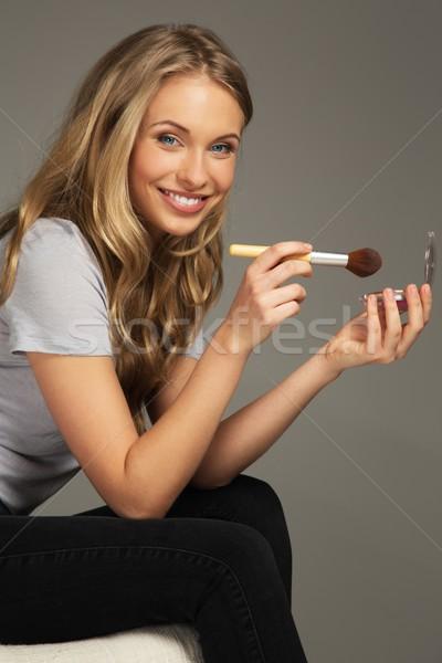 Pozitív fiatal nő hosszú haj jelentkezik mosoly arc Stock fotó © Nejron