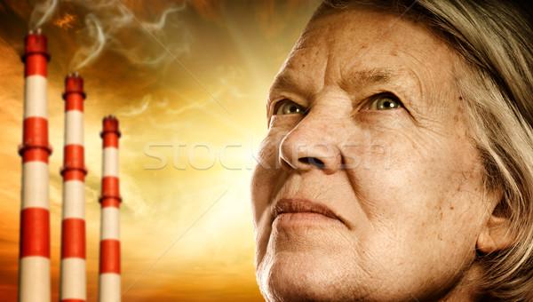 Elderly woman's face. Power plants on background Stock photo © Nejron
