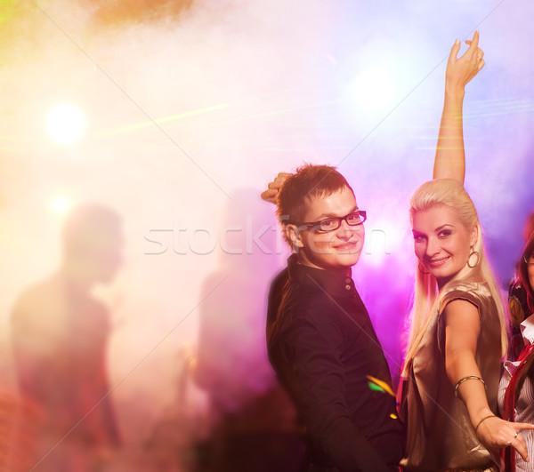 Happy couple in the night club Stock photo © Nejron