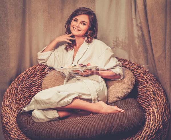 Kadın rahatlatıcı rahat sandalye plaka meyve Stok fotoğraf © Nejron