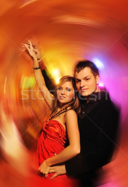 Young couple dancing in the night club   Stock photo © Nejron