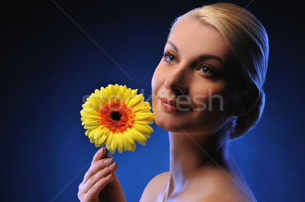 Close-up portrait of a beautiful woman with gerber flower Stock photo © Nejron