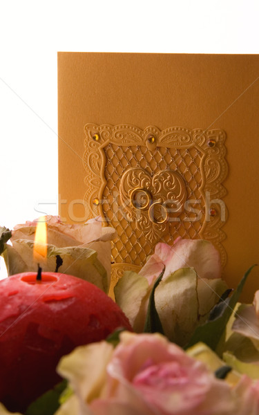Stock photo: Bouquet of roses and wedding card isolated over white