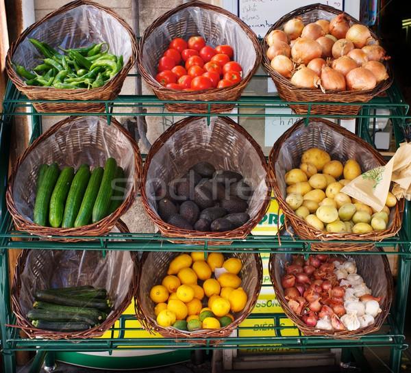 Vegetables in baskets on market place. Stock photo © Nejron
