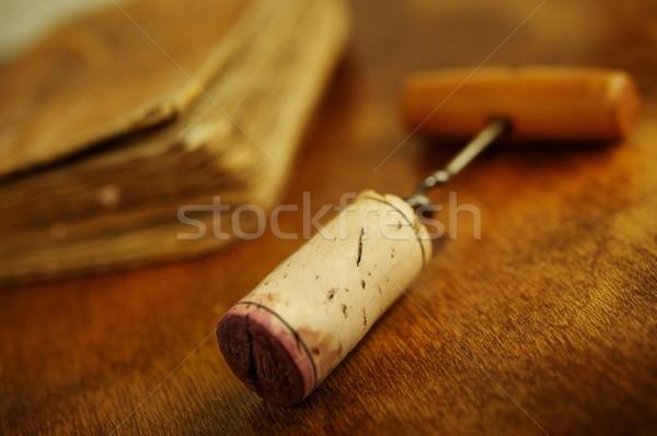 Corkscrew near a vintage book. Stock photo © Nejron