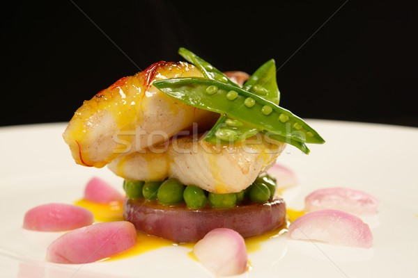 White fish fillet in sauce with radish and pies  Stock photo © Nejron
