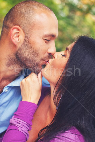 Happy smiling middle-aged couple kissing  outdoors Stock photo © Nejron