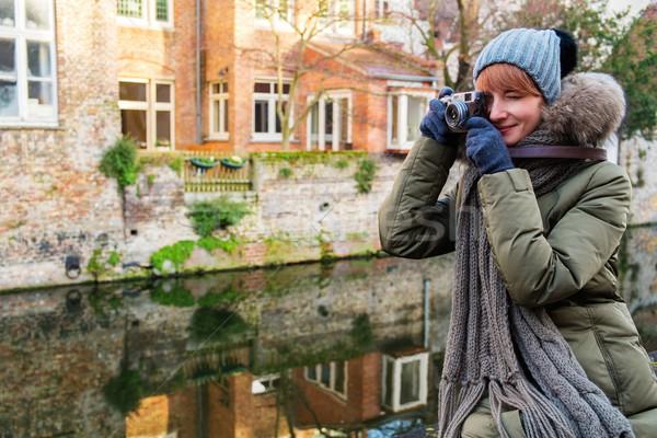 женщину туристических канал Бельгия здании моста Сток-фото © Nejron