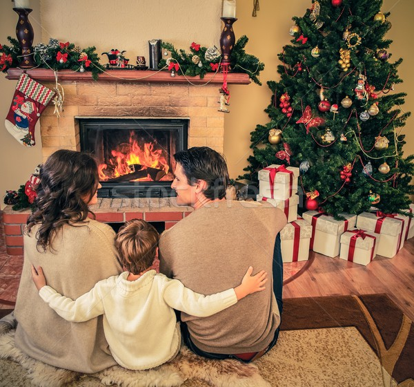 Family near fireplace in Christmas decorated house interior  Stock photo © Nejron