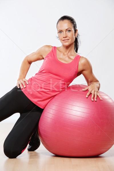 Beautiful athlete woman with a fitness ball. Stock photo © Nejron