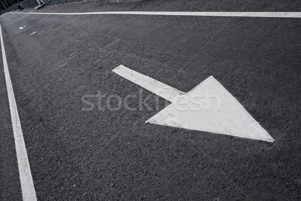 Drawn arrow on a lane. Stock photo © Nejron