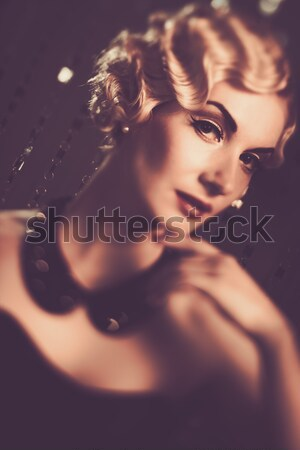 Portrait of a beautiful woman with rosebud  Stock photo © Nejron