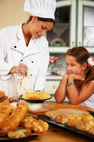 Mother cook with her daughter cooking homemade pastry Stock photo © Nejron