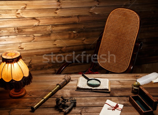 Rocking chair near table in homely wooden interior  Stock photo © Nejron