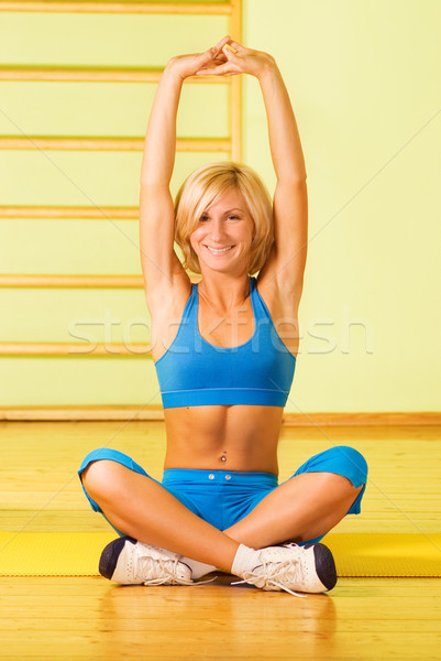Beautiful young woman relaxing after fitness exercise Stock photo © Nejron