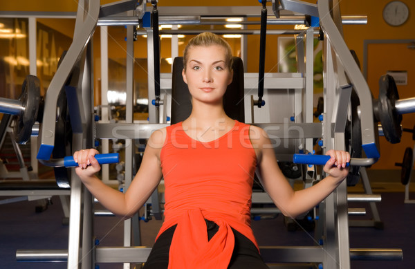 Beautiful woman works out in a gym Stock photo © Nejron