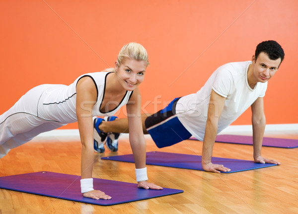Group of people completing push ups Stock photo © Nejron