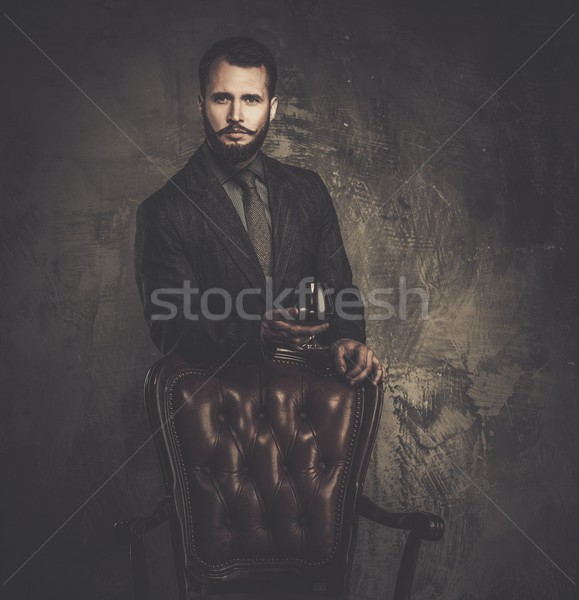 Handsome well-dressed with glass of beverage  Stock photo © Nejron