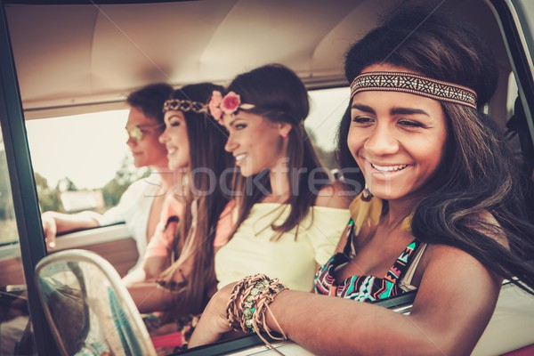Multi-ethnic hippie friends in a minivan on a road trip Stock photo © Nejron
