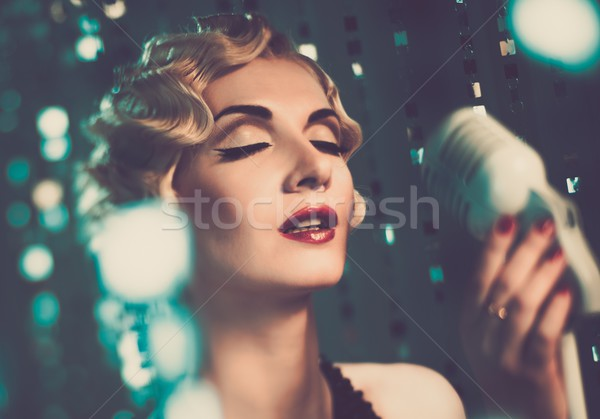 Elegant blond retro woman singer with beautiful hairdo  Stock photo © Nejron