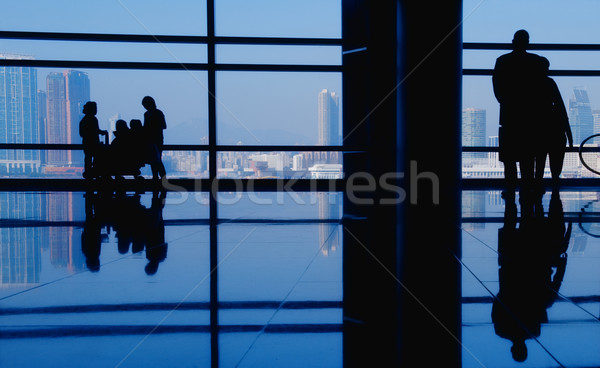 Edifício moderno pessoas silhuetas negócio cidade parede Foto stock © Nejron