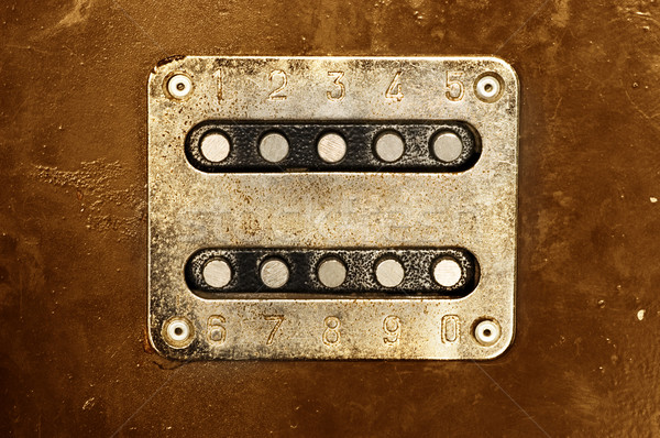 Rusty metal panel with buttons and numbers Stock photo © Nejron