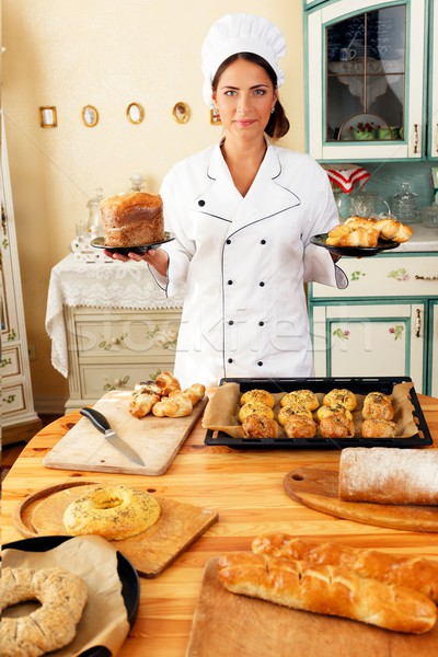 Woman cook holding plate with homemade baked goods Stock photo © Nejron