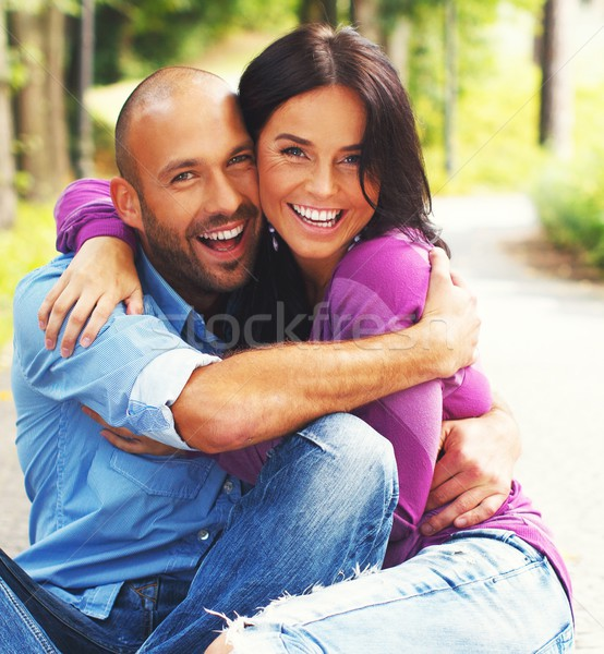 Gelukkig glimlachend paar buitenshuis vrouw Stockfoto © Nejron