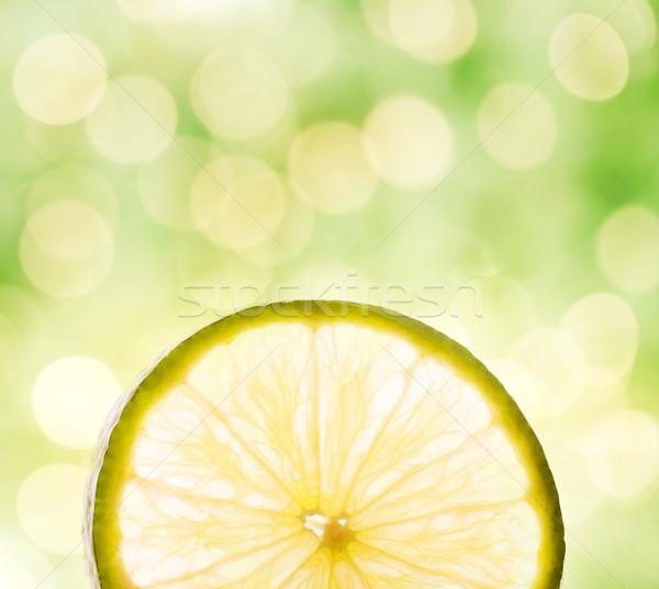 Lemon slice over abstract blurred background Stock photo © Nejron