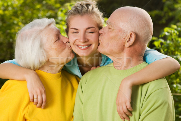 Grandparents kissing their granddaughter Stock photo © Nejron