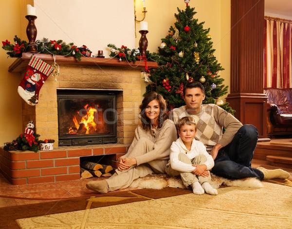Család kandalló karácsony díszített házbelső nő Stock fotó © Nejron