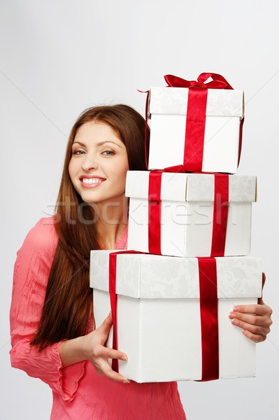 Stock photo: Beautiful brunette woman with a gift boxes