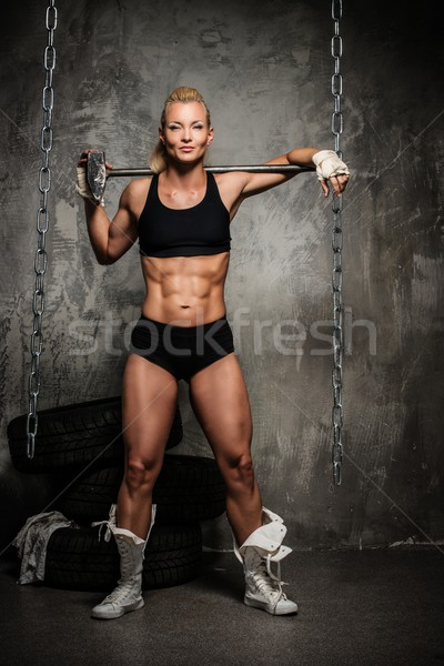 Beautiful muscular bodybuilder woman with a big hammer  Stock photo © Nejron