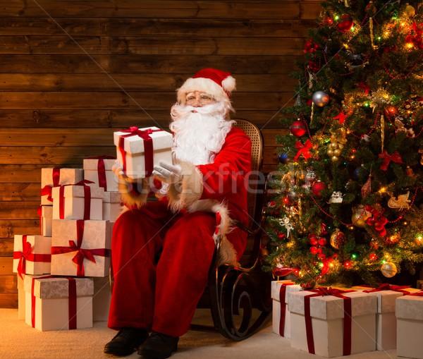 Papá noel sesión mecedora casa interior Foto stock © Nejron