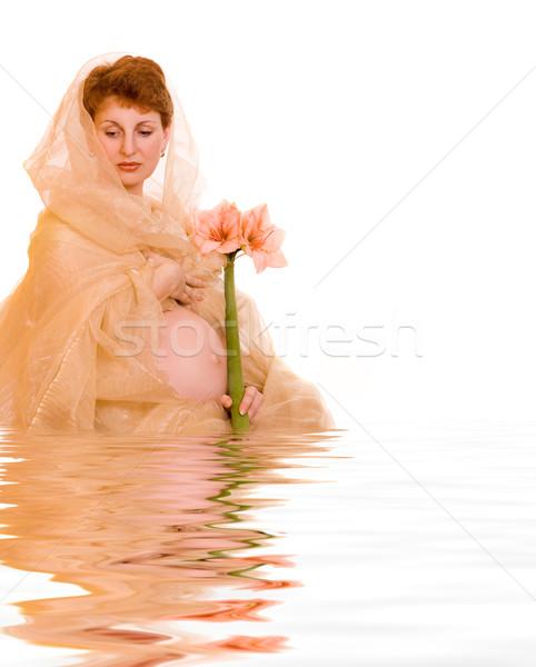 Сток-фото: красивой · молодые · беременная · женщина · цветок · оказанный · воды