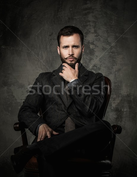 Handsome well-dressed  sitting in leather chair   Stock photo © Nejron