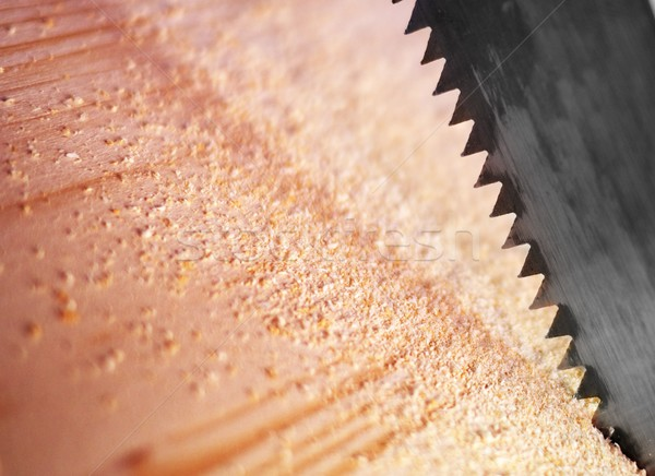 Close-up of a saw cutting wood furniture Stock photo © Nejron