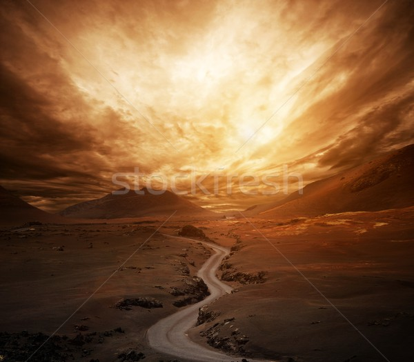 Dramatic sky over road in a valley. Stock photo © Nejron