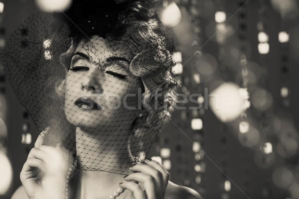 Monochrome portrait of elegant blond retro woman with beautiful hairdo wearing veil Stock photo © Nejron