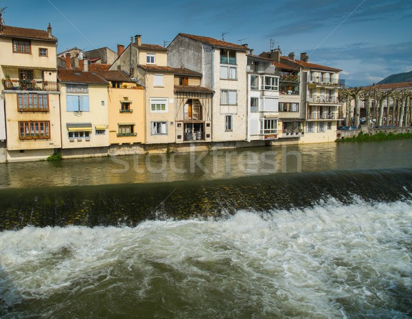 Houses standing on embankment of Salat river in Saint-Girons town, France Stock photo © Nejron