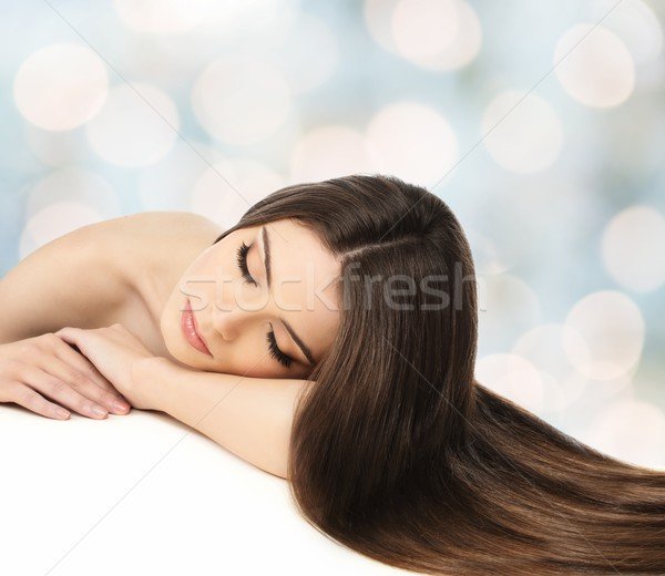 Beautiful young girl with long hair over blurred background Stock photo © Nejron