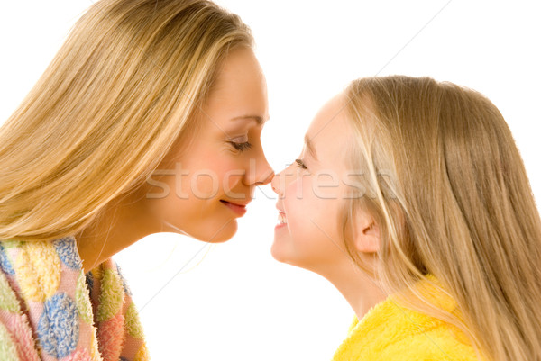 Mother and daughter close-up portrait isolated over white backgr Stock photo © Nejron