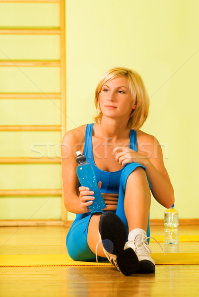 Beautiful woman relaxing after fitness exercise Stock photo © Nejron